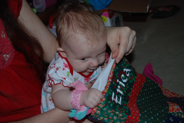Isabel sneaks a peek into mama's stocking